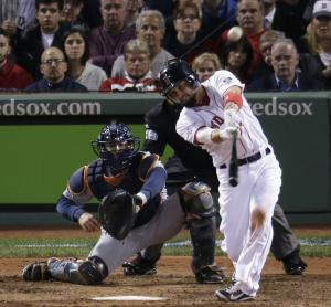 Boston Red Sox's Shane Victorino hits a grand slam against the Detroit Tigers in the seventh inning during Game 6 of the American League baseball championship series on Saturday, Oct. 19, 2013, in Boston. (AP Photo/Charlie Riedel)