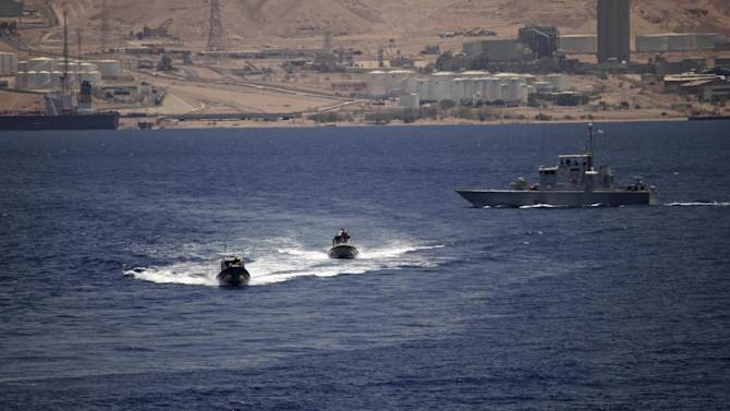 Jordanian naval patrol craft are seen during joint maneuvers with the U.S. Navy in the Gulf of Aqaba, Jordan as part of Eager Lion, a multinational military exercise, Tuesday, June 18, 2013. Under the watchful eye of stern-faced American advisers, hundreds of U.S.-trained Jordanian soldiers are holding war games that could eventually form the basis of an assault in Syria. There is fear of spillover from the Syrian war in this U.S.-allied kingdom, and the potential for a Jordanian role in securing Syria's chemical stockpiles should Bashar Assad's regime lose control. (AP Photo/Maya Alleruzzo)