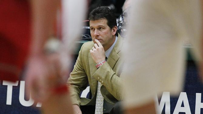 New Mexico head coach Steve Alford looks while framed between the legs of players in the second half of New Mexico's 91-82 victory over Colorado State in an NCAA basketball game in Fort Collins, Colo., on Saturday, Feb. 23, 2013. (AP Photo/David Zalubowski)