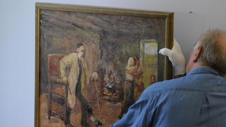 "In this picture taken Wednesday Sept. 7, 2011 an employee adjusts  the painting  ""Die Heimkehr des Tobias""  ( The Return of Tobias)  by German-Jewish painter Max Liebermann (1847-1935)  at the Centrum Judaicum in Berlin. Israel's national museum has returned an impressionistic painting to the estate of its creator, the German-Jewish Max Liebermann.   The work was looted from the Jewish Museum in Berlin, where it was on loan from the artist, in the 1930. Following the end of World War II, the American-based Jewish Restitution Successor Organization (JRSO) collected orphaned art and distributed the pieces to Jewish institutions worldwide. Liebermann's painting was one of more than 1,000 works the JRSO delivered in 1955 to the Bezalel National Museum, the precursor to the Israel Museum.  (AP Photo/dapd/ Michael Gottschalk)"