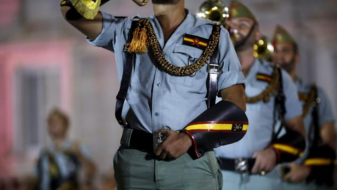 Spanish legionnaires take part in a military music parade outside the Royal Palace in Madrid