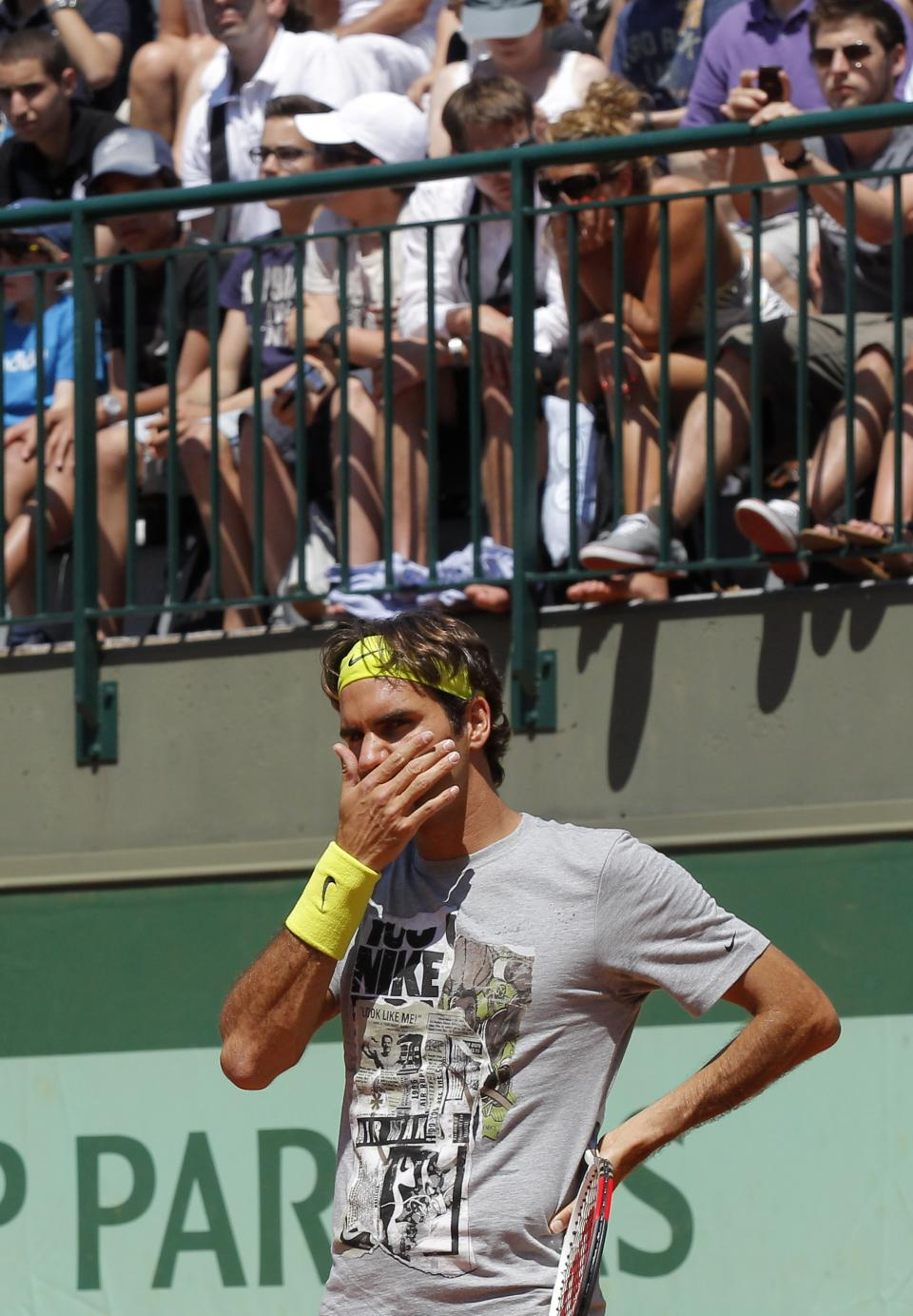 Switzerland's Roger Federer reacts during a training session for the French Open tennis tournament at the Roland Garros stadium in Paris, Saturday, May, 26, 2012.  (AP Photo/Michel Euler)