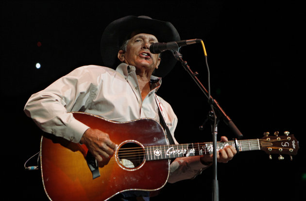 FILE - In this Oct. 17, 2011 file photo, George Strait performs during the Fire Relief, The Concert For Central Texas, at the Frank Erwin Center in Austin, Texas. The 60-year-old country music superstar on Wednesday, Sept. 26, 2012 announced that he&#39;ll embark on his final concert tour early next year. He made the announcement at a news conference at the Country Music Hall of Fame & Museum in Nashville, Tenn. (AP Photo/Erich Schlegel, File)