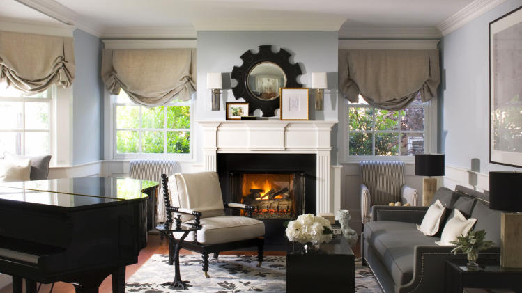 This publicity photo provided by Burnham Design shows a living room designed by Betsy Burnham that contrasts icy blue walls and white accents with shades of charcoal gray and black to create winter-inspired style that looks good during any season. (AP Photo/Burnham Design, Grey Crawford)