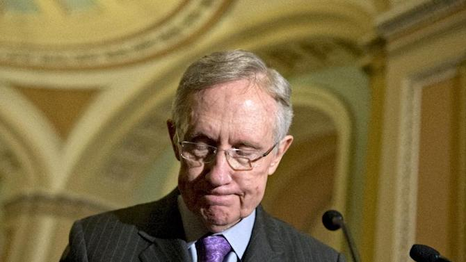 Senate Majority Leader Harry Reid of Nev. pauses as he meet with reporters  on Capitol in Washington, Tuesday, Nov. 27, 2012, following a Democratic strategy session.  (AP Photo/J. Scott Applewhite)