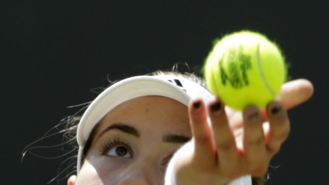 Garbine Muguruza of Spain serves to Angelique Kerber of Germany during their singles match at the All England Lawn Tennis Championships in Wimbledon, London, Saturday July 4, 2015. (AP Photo/Alastair Grant)