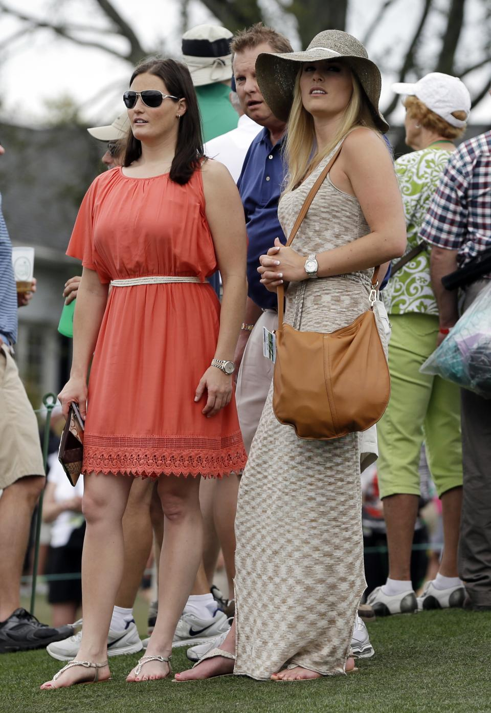 Skier Lindsey Vonn, right, watches Tiger Woods on the ninth hole during the first round of the Masters golf tournament Thursday, April 11, 2013, in Augusta, Ga. (AP Photo/Darron Cummings)