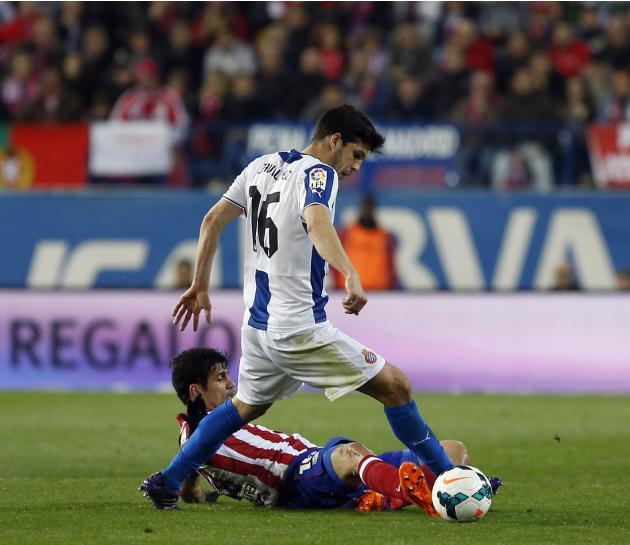 Atletico Madrid's Costa fights for the ball with Espanyol's Javi Lopez during their Spanish first division soccer match at Vicente Calderon stadium in Madrid,