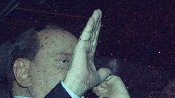 RESENDING TO PROVIDE AN ALTERNATIVE CROP OF ROM120 - Italian Premier Silvio Berlusconi waves to journalists as he leaves the Quirinale, Presidential palace, after meeting with Italian President Giorgio Napolitano in Rome, Tuesday, Nov. 8, 2011. Berlusconi won a much-watched vote Tuesday, but the result laid bare his lack of support in Parliament as financial pressure from the eurozone debt crisis pummeled Italy. (AP Photo/Andrew Medichini)