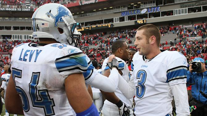 Detroit Lions place kicker Dave Rayner (3) celebrates with teammates, including Detroit Lions linebacker DeAndre Levy (54), after kicking the game-winning field goal against the Tampa Bay Buccaneers during an NFL football game Sunday, Dec. 19, 2010, in Tampa, Fla. The Lions won the game 23-20. (AP Photo/Margaret Bowles)
