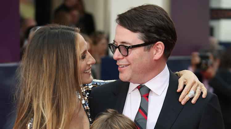 Sarah Jessica Parker, husband Matthew Broderick and their son James, arrive for the opening night of Charlie and the Chocolate Factory, a new stage musical based on Roald Dahl's popular story about Willy Wonka and his amazing Chocolate Factory, at the Drury Lane Theatre in central London, Tuesday, June 25, 2013. (Photo by Joel Ryan/Invision/AP)
