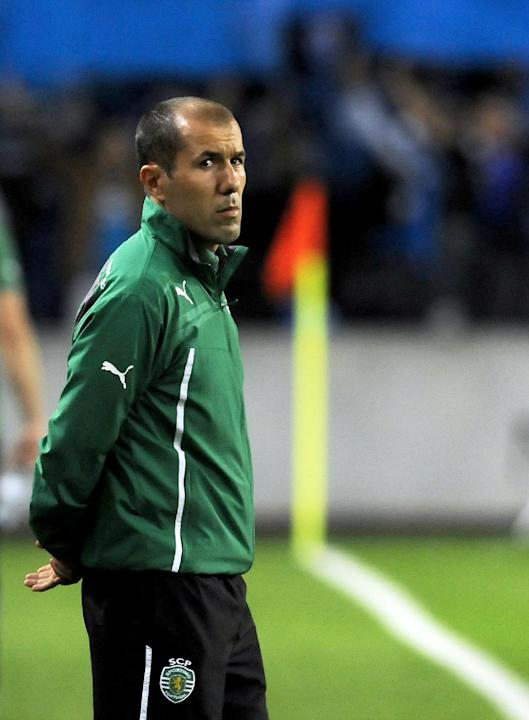 Sporting's coach Leonardo Jardim stands on the touch line prior to their 3-1 defeat against FC Porto in a Portuguese League soccer match at the Dragao stadium in Porto, Portugal, Sunday, Oct. 27, 2013