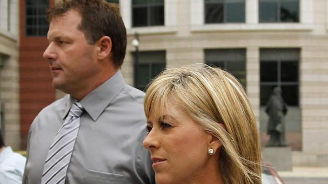 FILE - In this July 6, 2011 file photo, former Major League Baseball pitcher Roger Clemens, left, with his wife Debbie Clemens arrive at federal court in Washington. Debbie Clemens testified Friday that her husband was not present when she received a shot of human growth hormone from Roger Clemens' strength coach _ testimony that contradicts the star pitcher's chief accuser in the perjury trial. (AP Photo/Alex Brandon, File)