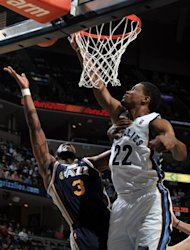 Memphis Grizzlies forward Rudy Gay (22) blocks a shot attempt by Utah Jazz forward DeMarre Carroll (3) in the first half of an NBA basketball game on Saturday, April 14, 2012, in Memphis, Tenn. (AP Photo/Nikki Boertman)