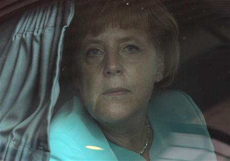 Germany's Chancellor Angela Merkel is seen inside a car as she leaves Ho Chi Minh City, October 12, 2011. Merkel left Ho Chi Minh City for Mongolia after a two-day visit to Vietnam. REUTERS/Kham