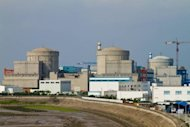 File photo of the Qinshan nuclear power plant in Haiyan, in eastern China&#39;s Zhejiang province. China has lifted a ban on new nuclear power stations imposed after Japan&#39;s Fukushima disaster last year, but will only approve projects proposed for coastal areas, the government said