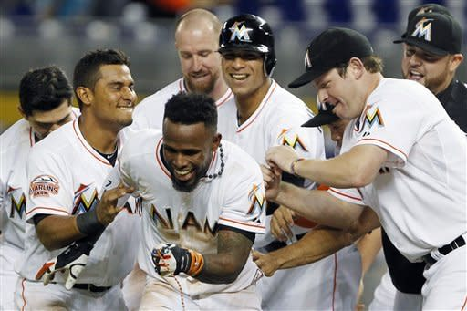 Reyes helps Marlins beat Braves 4-3 in 10