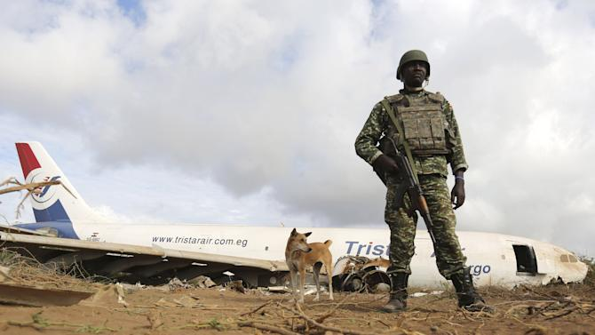 Ugandan soldier serving in AMISOM stands guard to secure the site where a Tristar Air Airbus A300-200F cargo plane crash-landed in Arbiska outside Somalia's capital Mogadishu