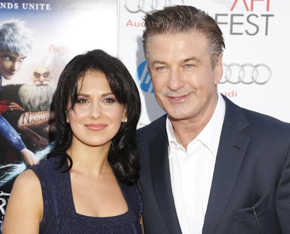 FILE - This Nov. 4, 2012 file photo shows actor Alec Baldwin, right, and his wife Hilaria Thomas at the &quot;Rise Of The Guardians&#39;&quot; special screening during the 2012 AFI FEST at Grauman&#39;s Chinese Theatre in the Hollywood section of Los Angeles. A representative for Alec Baldwin says the &quot;30 Rock&quot; star and his wife Hilaria are expecting their first child together. Baldwin, 54, is already the father of a 17-year-old daughter, Ireland, from his previous marriage to actress Kim Basinger (Photo by Todd Williamson/Invision/AP, file)