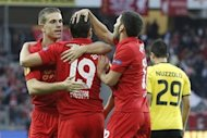 Liverpool's Jordan Henderson, Stewart Downing and Daniel Pacheco, from left,  celebrate after scoring the opening goal during the UEFA Europa League Group A soccer match between BSC Young Boys Bern and Liverpool FC at the Stade de Suisse in Bern, Switzerland, Thursday, September 20, 2012. (AP Photo/Peter Klaunzer/Keystone)