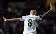Swansea City's Jonjo Shelvey waves to Liverpool supporters after scoring a goal during their English Premier League soccer match at the Liberty Stadium in Swansea, Wales September 16, 2013. REUTERS/Rebecca Naden