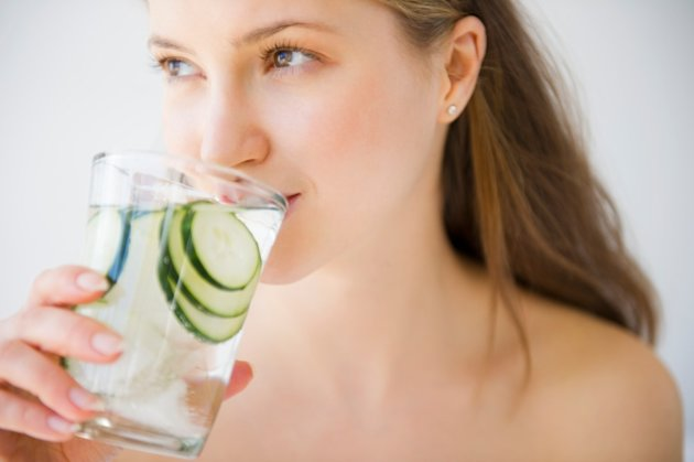 Woman Drinking Water with cucumber