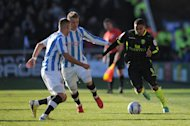 Jerome Thomas, right, and Alan Tate have been a big boost to Leeds according to Neil Warnock