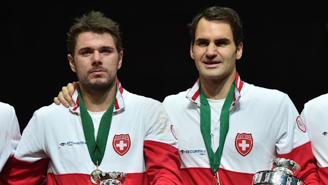 Roger Federer (right) and Stan Wawrinka celebrate after Switzerland beat France in the 2014 Davis Cup final in France