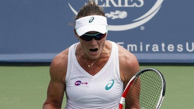 Samantha Stosur of Australia celebrates after winning her first round match against Svetlana Kuznetsova of Russia at the Women's Cincinnati Open (Reuters)