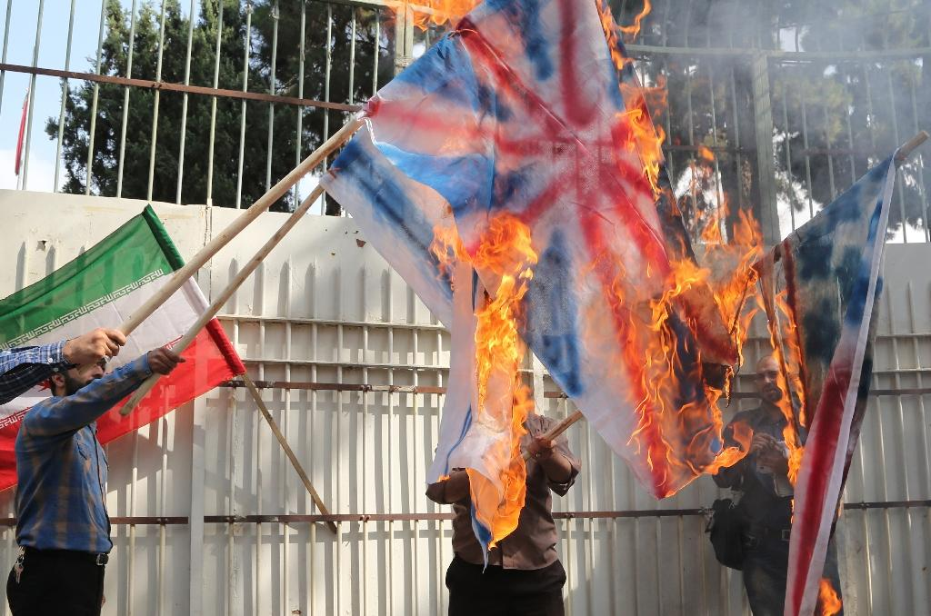 Iran militia burns 'enemy' flags outside ex-US embassy