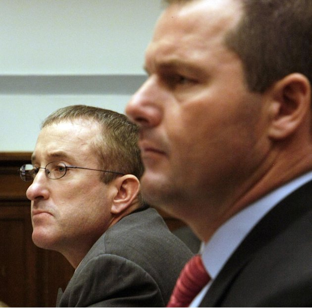 FILE - In this Feb. 13, 2008, file photo, Roger Clemens, right, and his former personal trainer Brian McNamee, left, testify on Capitol Hill in Washington before the House Oversight, and Government Re