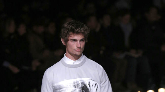 A model presents a creation by designer Riccardo Tisci for Givenchy as part of his men's fall-winter 2013/2014 fashion collection, presented in Paris, Friday, Jan. 18, 2013. (AP Photo/Christophe Ena)