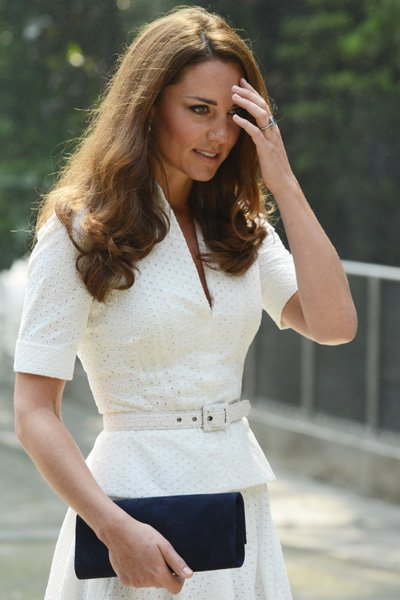 The Duchess completes the outfit with her favourite black wedges and matching clutch. (Photo by Mark Large - Pool/Getty Images)