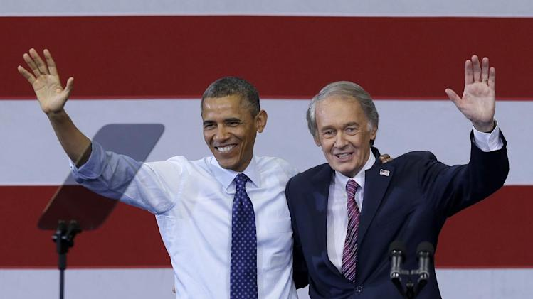 President Barack Obama and Massachusetts Democratic Senate candidate Rep. Ed Markey wave during a campaign rally For Markey in Boston's Roxbury neighborhood, Wednesday, June 12, 2013. Obama is stumping for Markey hoping to give him an edge over Republican Gabriel Gomez in Massachusetts' U.S. Senate special election. (AP Photo/Elise Amendola)
