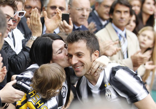 Juventus' Alessandro Del Piero is kissed by his wife Sonia Amoruso after winning their 28th Italian Serie A title at the end of their match against Atalanta in Turin