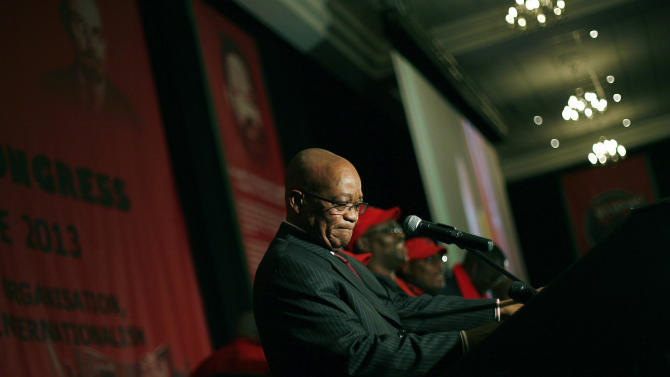 """FILE - In this Wednesday June 26, 2013, file photo, South African President Jacob Zuma addresses the 10th annual meeting of the National Education Health & Allied Workers in Johannesburg. During his speech, Zuma said Nelson Mandela was """"still critical"""" and that we must """"pray every minute"""". (AP Photo/Jerome Delay, File)"""