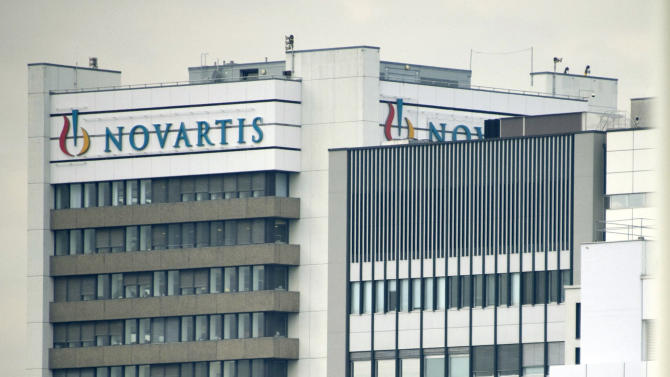FILE - This Oct. 25, 2011 file photo shows the logo of Swiss pharmaceutical company Novartis AG on one of their buildings in Basel, Switzerland. Novartis AG on Thursday, Oct. 25, 2012, reported a net profit of $2.48 billion during the third quarter, with income remaining flat as new drugs offset patent expirations. The Basel-based company's profits between July and September were virtually unchanged from $2.49 billion in the third quarter of 2011.  (AP Photo/Keystone, Georgios Kefalas, File).