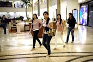 Shoppers at the Emporio shopping mall in New Delhi. India&#39;s consumer spending is at its weakest in seven years, global ratings agency Fitch said on Tuesday, as it cut the outlook for India&#39;s vast retail sector from stable to negative