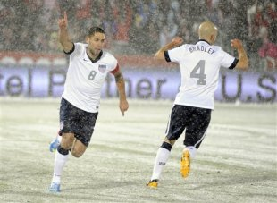Clint Dempsey (8) celebrates his winning goal with Michael Bradley (4) against Costa Rica. (AP)