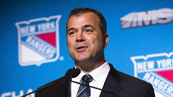 Alain Vigneault speaks during a news conference after being named the New York Rangers new hockey head coach at Radio City Music Hall, Friday, June 21, 2013, in New York. Vigneault, 52, comes to the Rangers after seven years as coach of the Vancouver Canucks. (AP Photo/John Minchillo)
