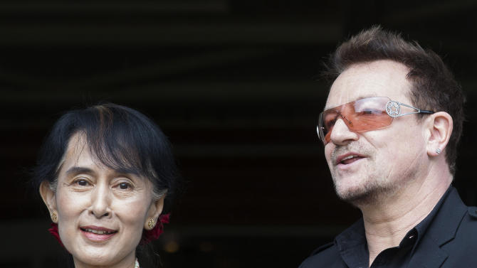 Irish singer and activist Bono and Myanmar's opposition leader Aung San Suu Kyi, left, pose for the media after attending a conference of the Oslo Forum at the Losby Gods resort, about 13 kilometers (8 miles) east of Oslo, Monday, June 18, 2012. The Oslo Forum is an international network of armed conflict mediation practitioners. (AP Photo/Markus Schreiber)