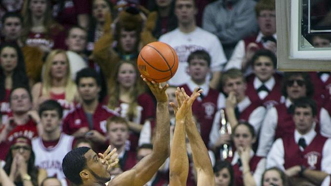 Indiana's Jeremy Hollowell (33) shoots against Michigan's Jon Horford (15) during the first half of an NCAA college basketball game Saturday, Feb. 2, 2013, in Bloomington, Ind. (AP Photo/Doug McSchooler)