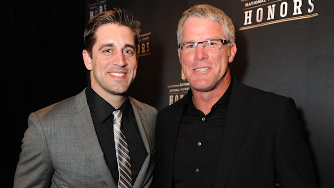 From left, Aaron Rodgers of the Green Bay Packers and Brett Favre at the 2nd Annual NFL Honors on Saturday, Feb. 2, 2013 in New Orleans. (Photo by Jordan Strauss/Invision/AP)
