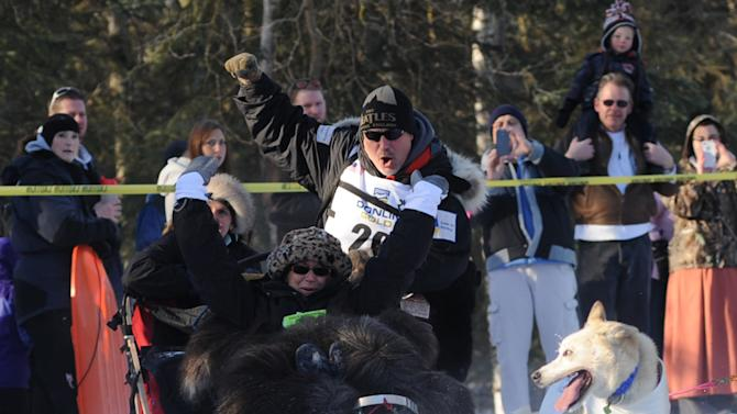 In a Saturday, March 1, 2014 photo, Scott Janssen keeps control of his sled rounding the corner near Goose Lake during the ceremonial start for Iditarod 42 in Anchorage, Ak. Janssen, an Anchorage undertaker known as the Mushing Mortician, was back home early Wednesday, Feb. 5 after he was flown to a hospital after a harrowing ordeal that included crashing his sled, hitting his head on a stump and later falling through ice and breaking his ankle. (AP Photo/Anchorage Daily News,Anne Raup)