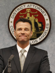 Los Angeles Deputy District Attorney David Walgren smiles while speaking to the media after Dr. Conrad Murray was sentenced to four years in county jail for his involuntary manslaughter conviction of pop star Michael Jackson on Tuesday, Nov. 29, 2011 in Superior Court in Los Angeles. (AP Photo/Mario Anzuoni, Pool)