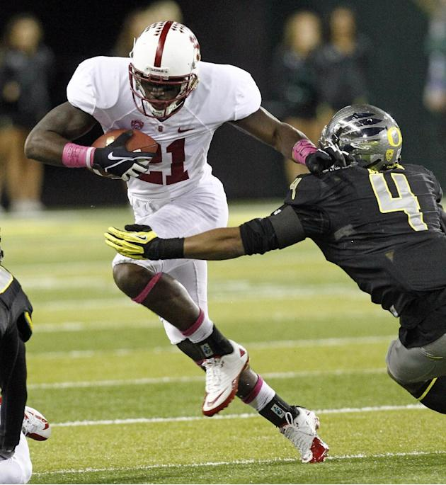 Stanford receiver Jamal-Rashad Patterson, left, tries to elude Oregon defender Erick Dargan during the first half of their NCAA college football game in Eugene, Ore., Saturday, Nov. 17, 2012.(AP Photo