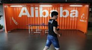 A Chinese Alibaba employee walks through a communal space at the company headquarters in Hangzhou in June 2012. Chinese e-commerce giant Alibaba announced that it has bought back billions of dollars worth of stock from Yahoo! in a step toward independence from the US Internet pioneer