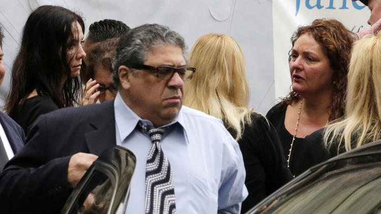 "Actor Vincent Pastore and actress Aida Turturro, right, arrive for the funeral service of James Gandolfini, star of ""The Sopranos,"" in New York's the Cathedral Church of Saint John the Divine, Thursday, June 27, 2013. The 51-year-old actor died of a heart attack last week while vacationing in Italy with his son.(AP Photo/Richard Drew)"