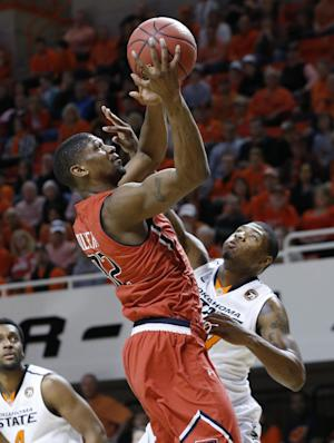 Smart returns, leads OSU past Texas Tech 84-62
