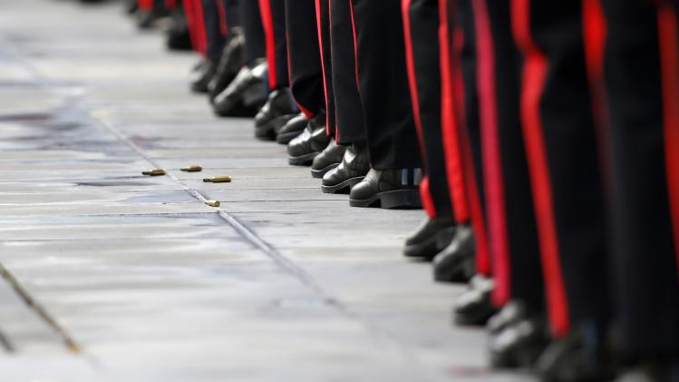 Armed Forces of Malta soldiers march as spent rifle cartridges lie on the ground during a military parade to mark Malta's Republic Day in Valletta